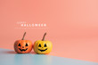 canvas print picture Happy Halloween message, Pumpkin on pastel paper background.
