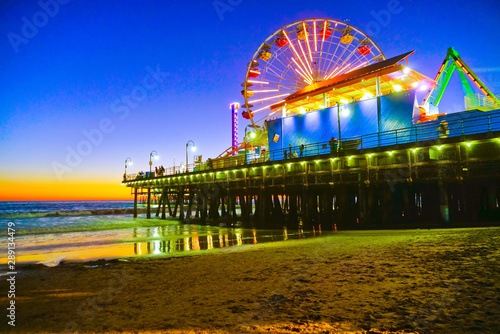 View of Santa Monica Pier on the beach at twilight. © Javen