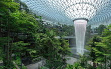 Jewel Changi Airport Is A New Terminal Building Under A Glass Dome, With Indoor Waterfall And Tropical Forest, Shopping Malls And Dining, In Singapore