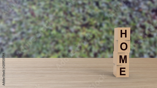 Home word Wooden cubes on table vertical over blur background HD with climbing green leaves, mock up, template, banner with copy space for text, find house, rent apartment, happy family