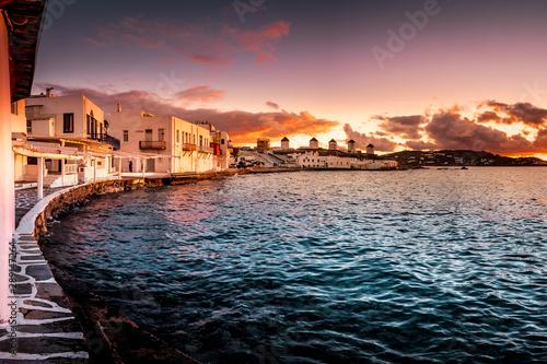 The white windmills of Mykonos Island, famous Mykonos sunset, Kato Mili close to Little Venice, Cyclades, Greece