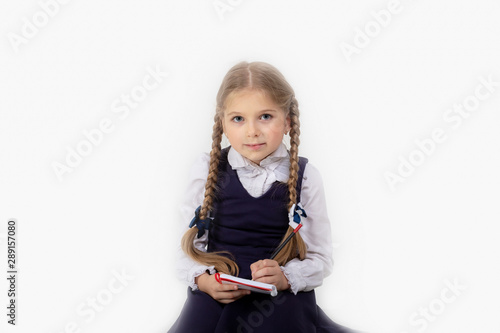 Schoolgirl write in notebook on yellow background Canvas Print