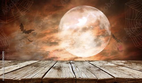 Obraz na plátně  Empty wooden table - Halloween background