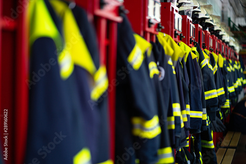 Firefighter suits and helmets at fire station