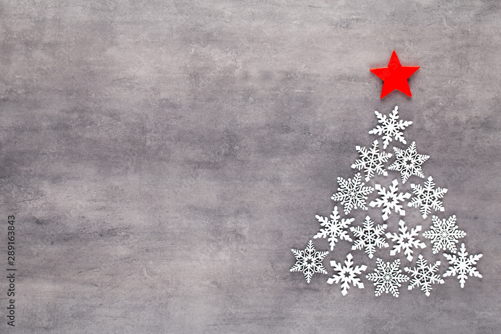 Fototapety, obrazy: Christmas tree made from white snow flake decoration on gray background. Flat lay, top view