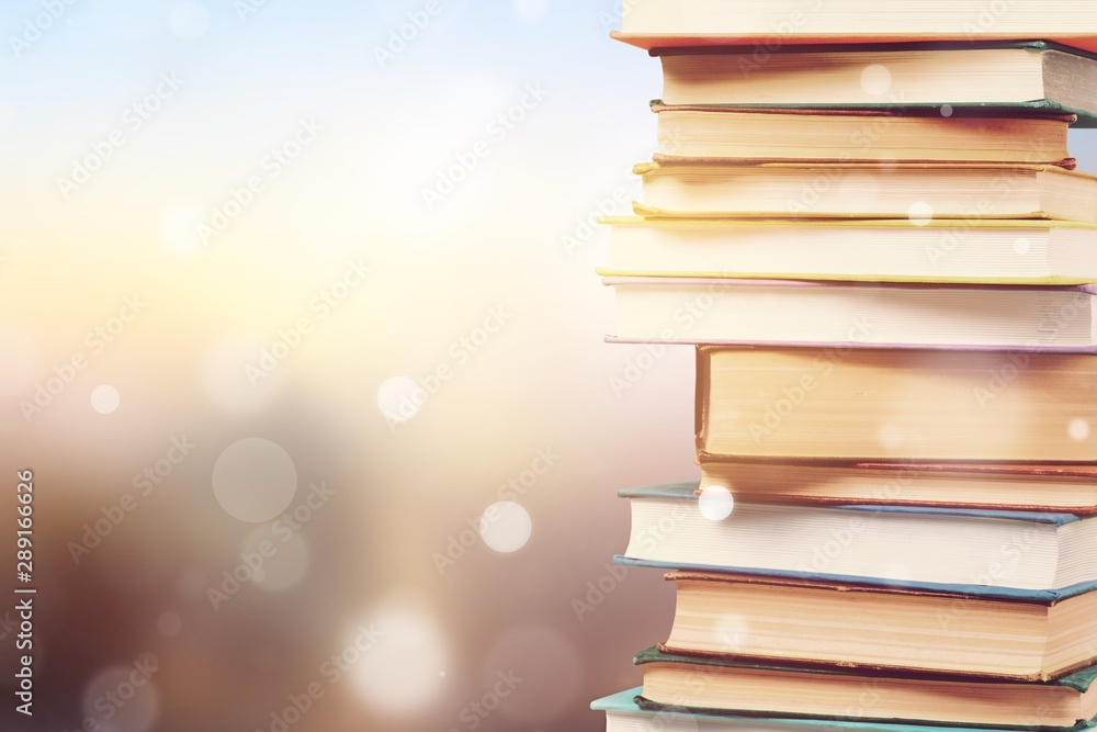 Fototapeta Stack of colorful books on blurred background
