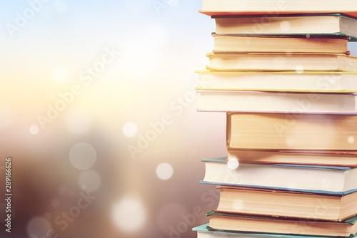 Fotografie, Obraz  Stack of colorful books on blurred background