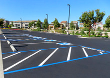 Freshly Resurfaced And Repainted Handicap Parking Space In A Parking Lot. The Number Of Handicap Spaces Increases With The Size Of The Lot, Requiring Roughly One Handicapped Spot Per 25 Spaces.