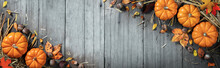 Autumn - Wooden Table Background Decorated With Pumpkins, Leaves, Acorns And Straw