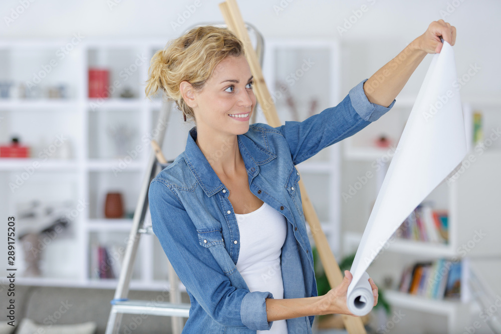 Fototapety, obrazy: woman with roll of wallpaper