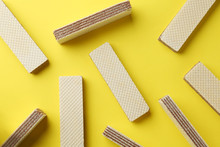 Tasty Wafer Sticks On Yellow Background, Flat Lay. Sweet Food