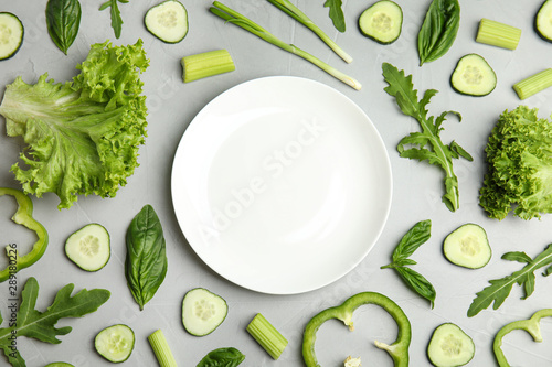 Fototapeta Flat lay composition with fresh salad ingredients on grey background, space for text obraz