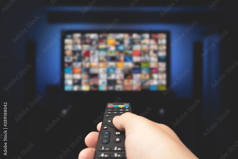Fototapeta Multimedia video concept on TV set in dark room