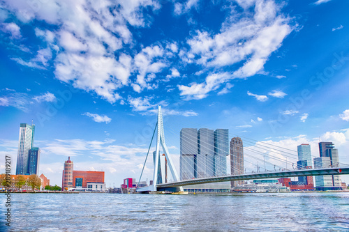 Spoed Fotobehang Rotterdam Attractive View of Renowned Erasmusbrug (Swan Bridge) in Rotterdam in front of Port and Harbour. Picture Made At Day.