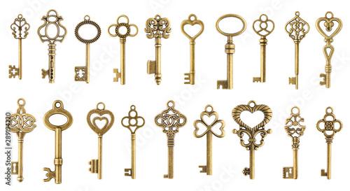 Obraz Set of vintage golden skeleton keys isolated on white background - fototapety do salonu
