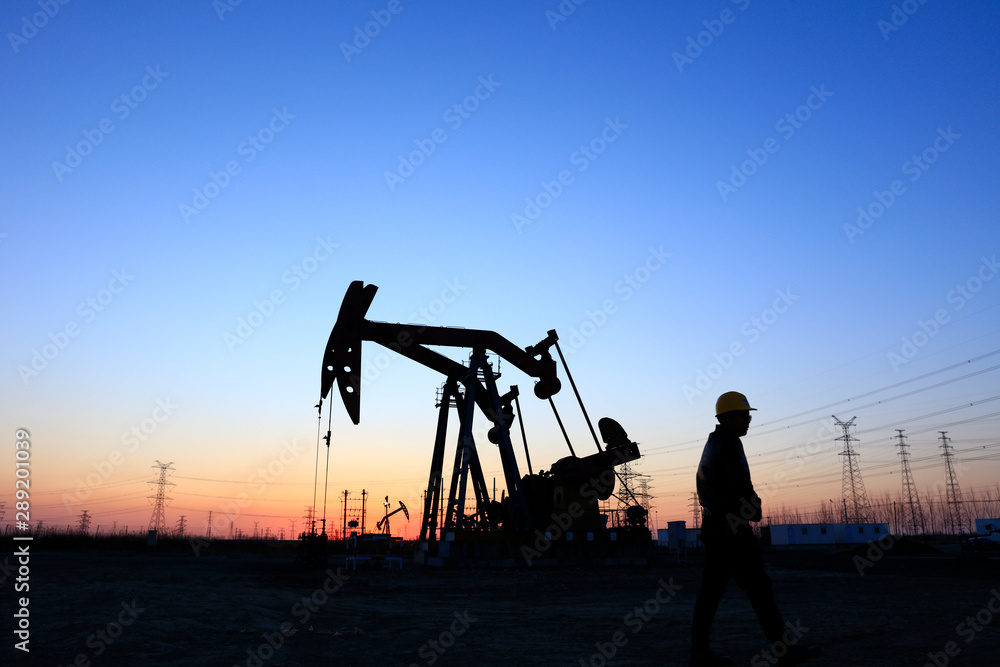 Fototapeta oil field, the oil workers are working