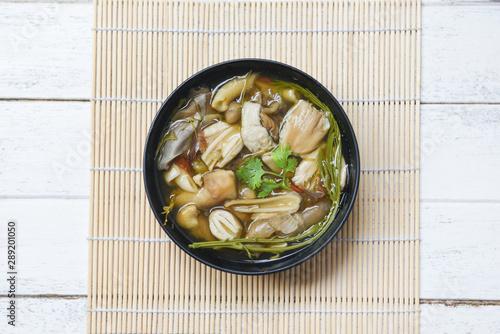 Photo Mushroom soup bowl - Yellow wild mushroom or grisette Amanita hemibapha vaginata