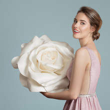 Beautiful Charming Woman Holding Giant White Rose In Her Hands.
