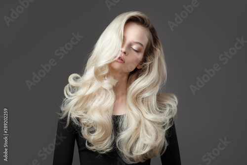 Fotografie, Tablou Beautiful young woman. Gorgeous blonde hair.