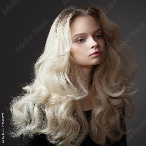 Obraz na plátne Beautiful young woman. Gorgeous blonde hair.