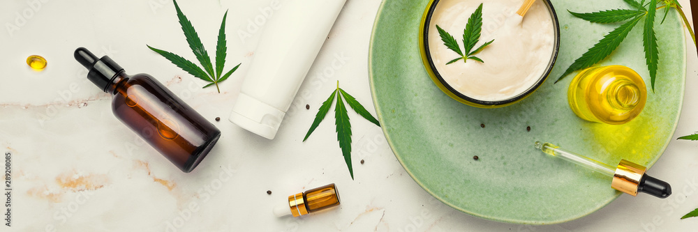 Fototapety, obrazy: Cosmetics with cannabis oil on a turquoise plate on a light marble background. Copy space, mockup. Banner