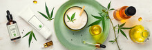 Cosmetics With Cannabis Oil On A Turquoise Plate On A Light Marble Background. Concept Of Luxury Skin Care. Banner