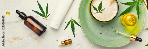 Fotografie, Obraz  Cosmetics with cannabis oil on a turquoise plate on a light marble background