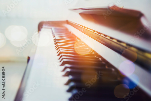 Obraz selective and soft focus of piano keys with bokeh light effected - fototapety do salonu