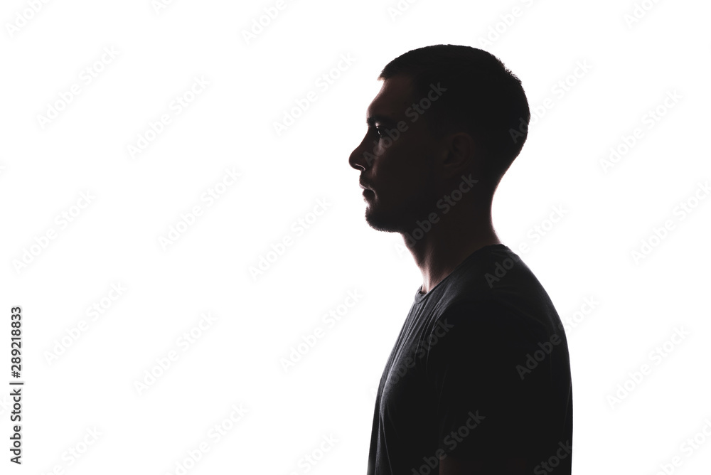Fototapeta Silhouette portrait of young European man in profile isolated on white background