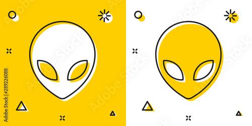 Платно  Black Alien icon isolated on yellow and white background