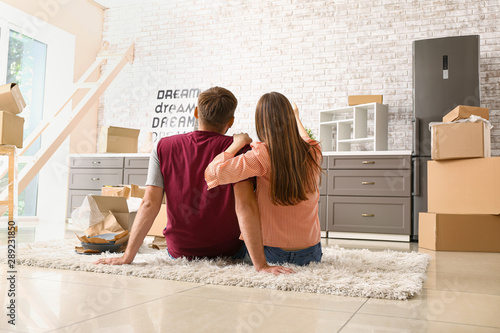 Valokuva  Young couple planning design of their new house