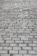 Traditional textured stone pavement street. Granite block surface ground
