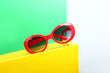 canvas print picture - Stylish sunglasses on color background