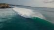Surfers riding a waves blue ocean wave