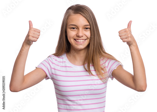 Portrait of teen girl making Thumb up Gesture, isolated on white background Canvas Print