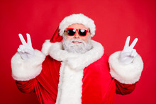 Close-up Portrait Of His He Nice Attractive Cheerful Cheery Peaceful Bearded Santa Showing Double V-sgn Festive Festal Mood Isolated Over Bright Vivid Shine Red Background