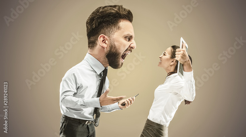 Fotografía  Angry businessman screaming at employee in the office