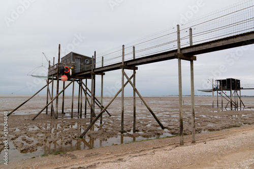 Fotografie, Tablou wooden fishing hut shack to trawl the estuary french carrelet on west coast of F