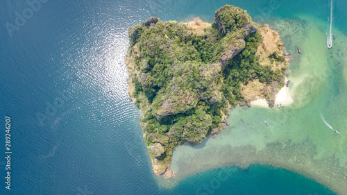 Foto auf Leinwand Olivgrun Aerial drone view of tropical islands, beaches and boats in blue clear Andaman sea water from above, beautiful archipelago islands of Krabi, Thailand