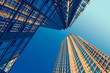 canvas print picture - Looking up at business buildings