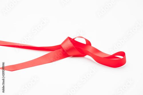 Cinta roja sobre fondo blanco para hacer lazos y decorar los regalos de navidad, regalos de anniversario, regalos en general Canvas Print