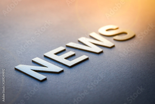 Fototapeta Word news written with white solid letters obraz