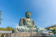 Monumental Outdoor Bronze Statue The Great Buddha In Kamakura, Japan. Wide Angle View With Clear Blue Sky