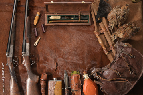 Fotografija Hunting concept with woodcock, shotgun, knife and ammunition for hunting arranged on brown background