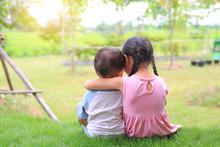 Older Sister Hugs Little Broth...