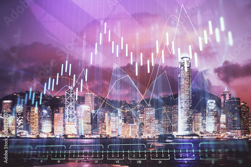 Fotografie, Obraz  Double exposure of forex chart drawings over cityscape background