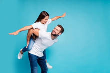 Profile Side Photo Of Cheerful People Holding Hands Playing Piggyback Wearing White T-shirt Denim Jeans Isolated Over Blue Background