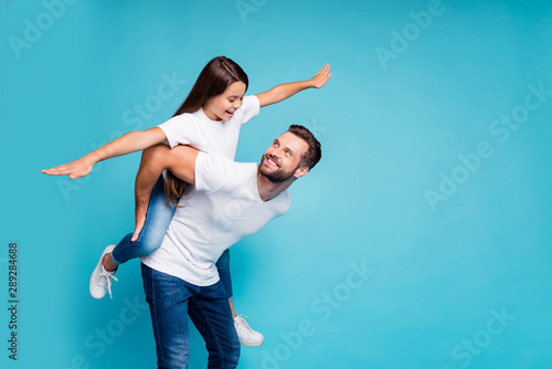 Fotografie, Tablou  Profile side photo of cheerful people holding hands playing piggyback wearing wh