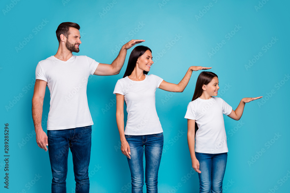 Fototapety, obrazy: Profile side photo of sweet parent and their daughter with brunet hair holding hand looking wearing white t-shirt denim jeans isolated over blue background