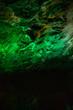 Beautiful illuminated multicolored stalactites in Danzhou Stone Flower Caves, Geopark next to Haikou, Hainan, China